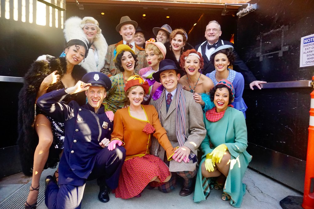 Joshua Burrage and the cast of  Singin' in the Rain