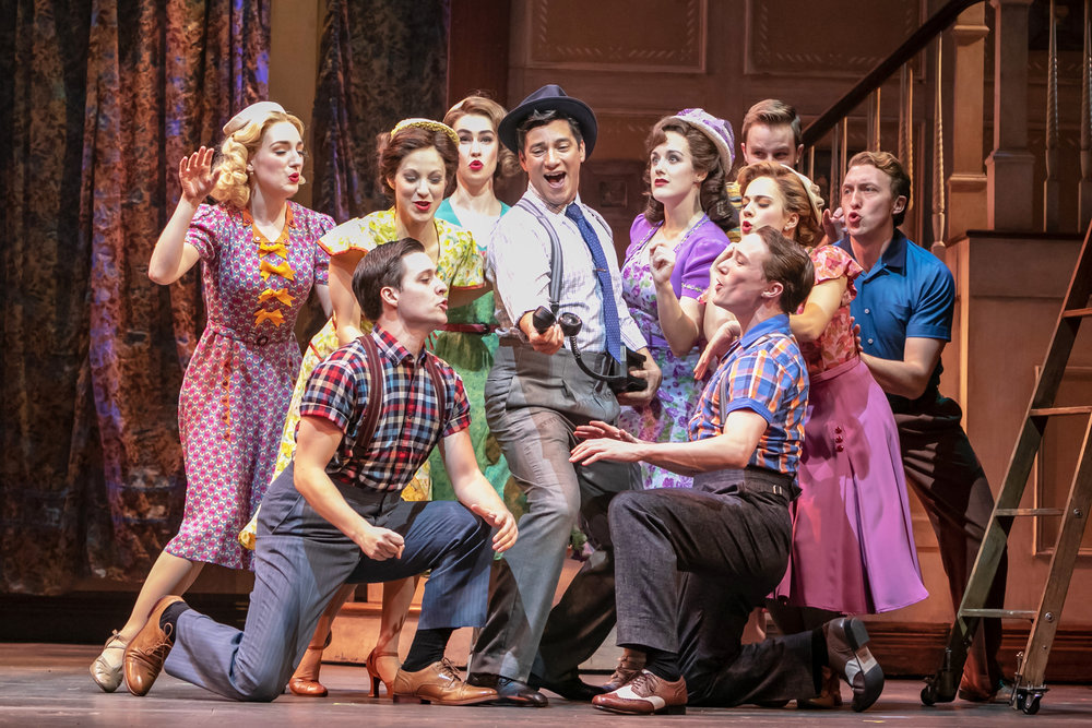 Amy Van Norstrand (fifth from right) in  Holiday Inn  at Paper Mill Playhouse