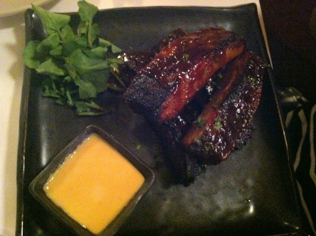 Barbecue Ribs appetizer with spicy mustard sauce