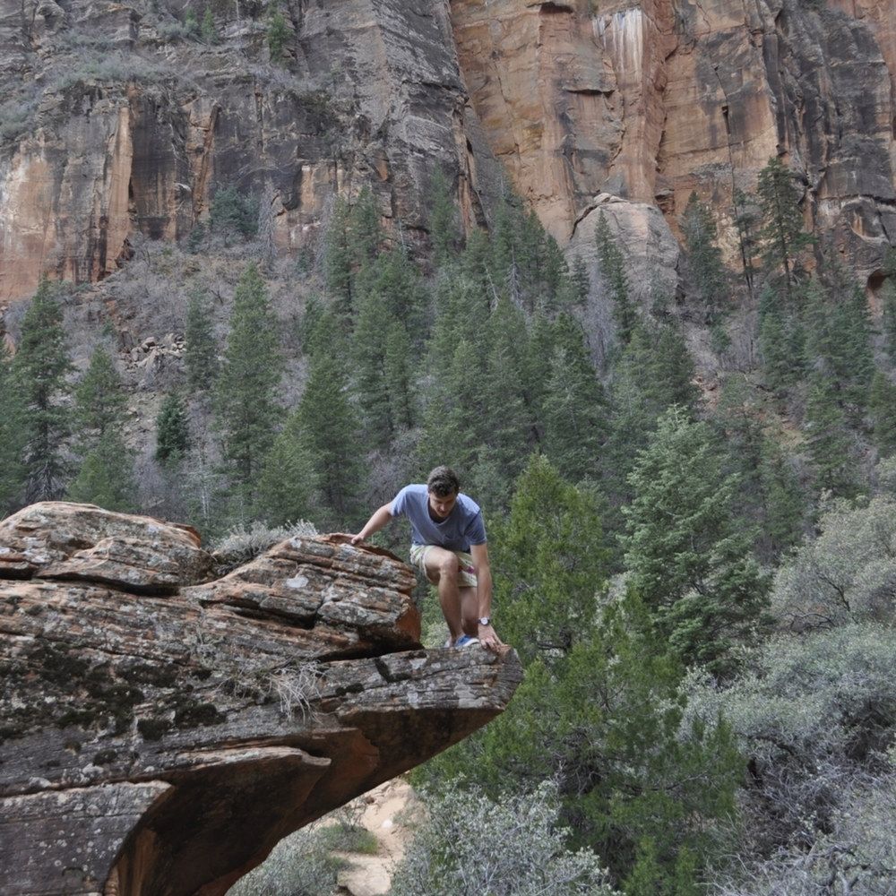 Climbing a boulder at Zion. This is on the Emerald Pools Hike.