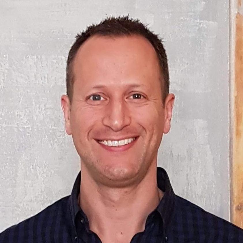 Ari Lustbader,  Director