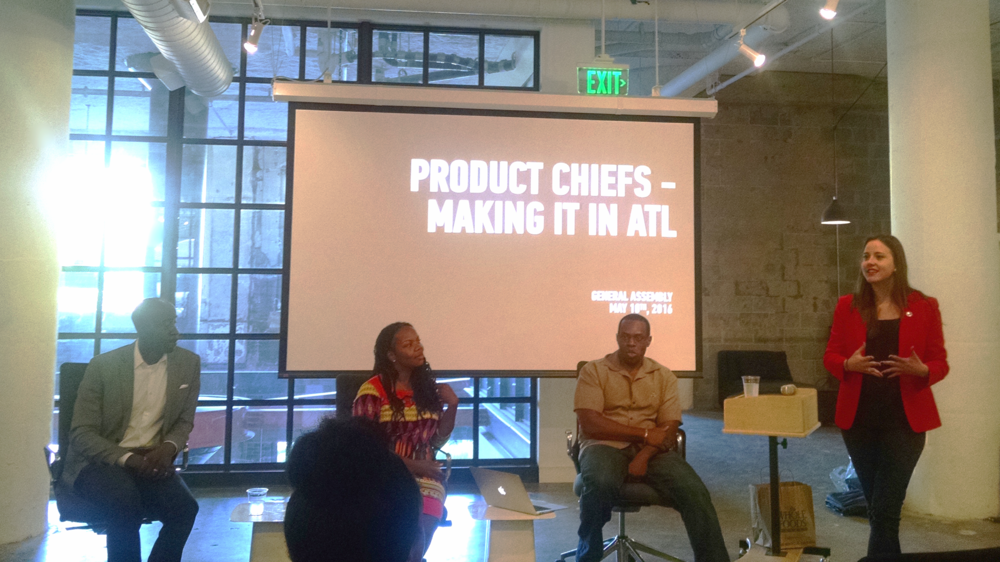 """Product Chiefs"" panel  featuring Chidi Afulezi, co-founder of aKoma; Melissa Proctor, Atlanta Hawks CMO; and Junior Gaspard, SVP- Product, Sales & Marketing at Experience, with an introduction by Amelia Davis, Local Marketing Producer at General Assembly. (And a window glare because I am clearly not a professional photographer. #knowyourstrengths)"