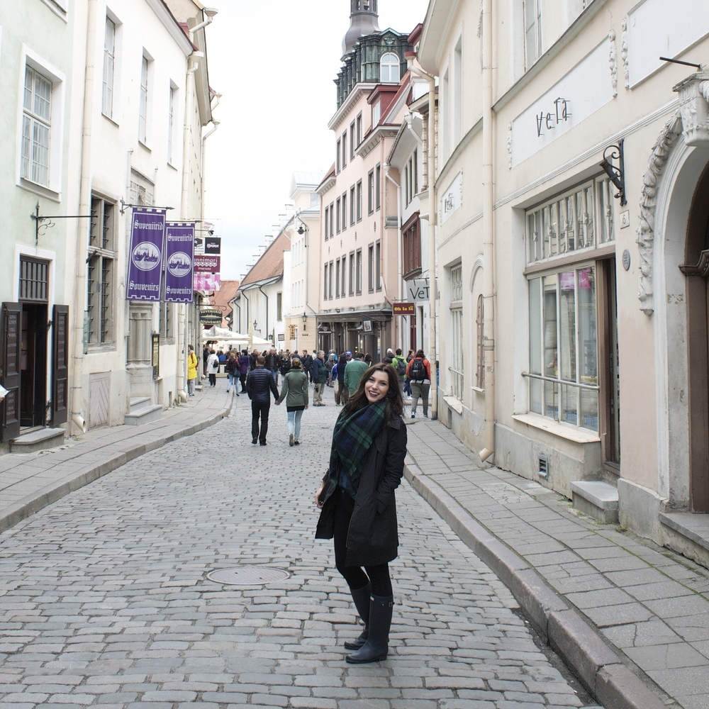 Walking the streets of rainy Estonia in Hunter packable rainboots, Cole Haan raincoat (similar), Zara plaid scarf, Vince jeans, Gap denim button up (buy a size or two larger for a super cool oversized fit).
