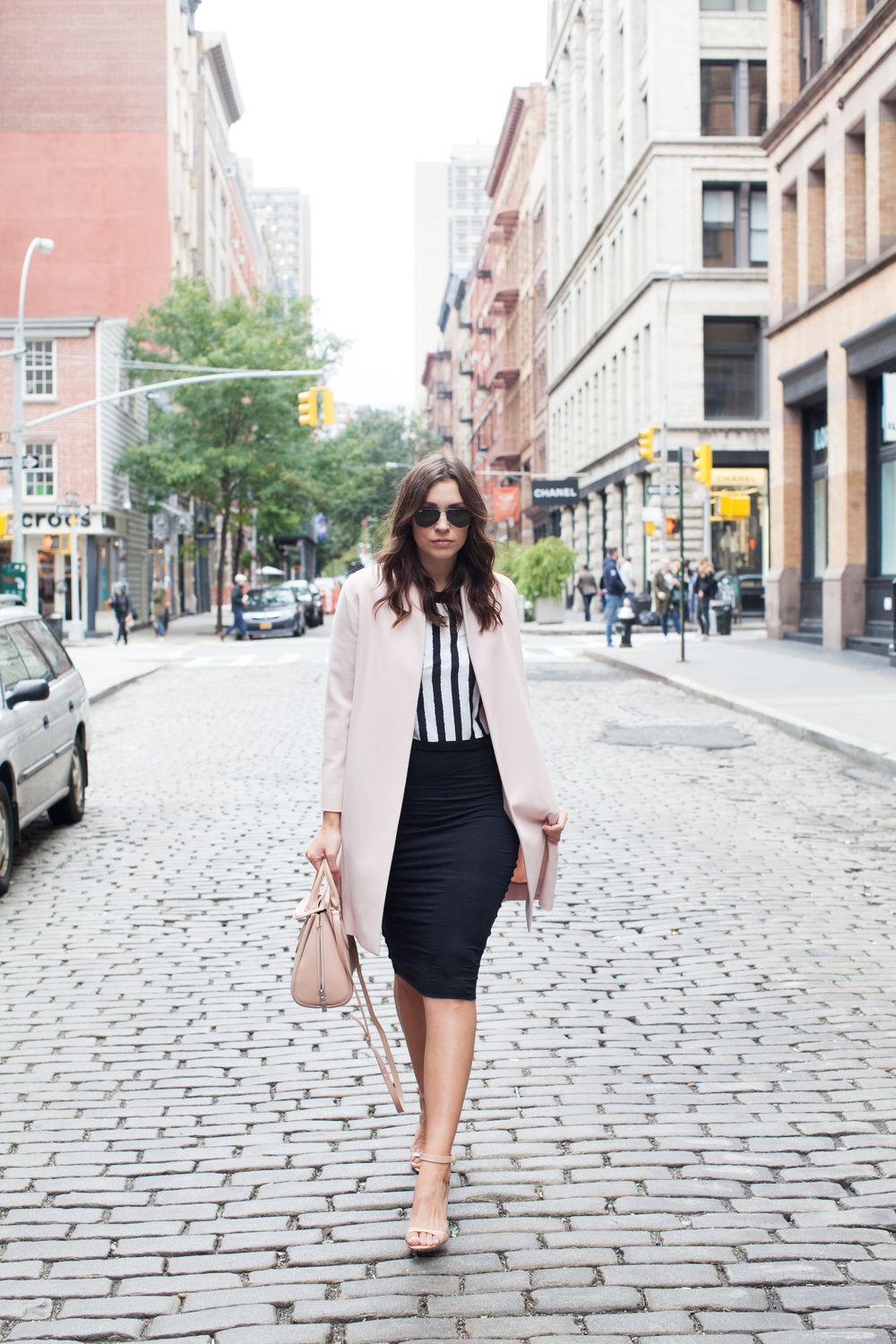 pink coat over stripe crop top and black pencil skirt