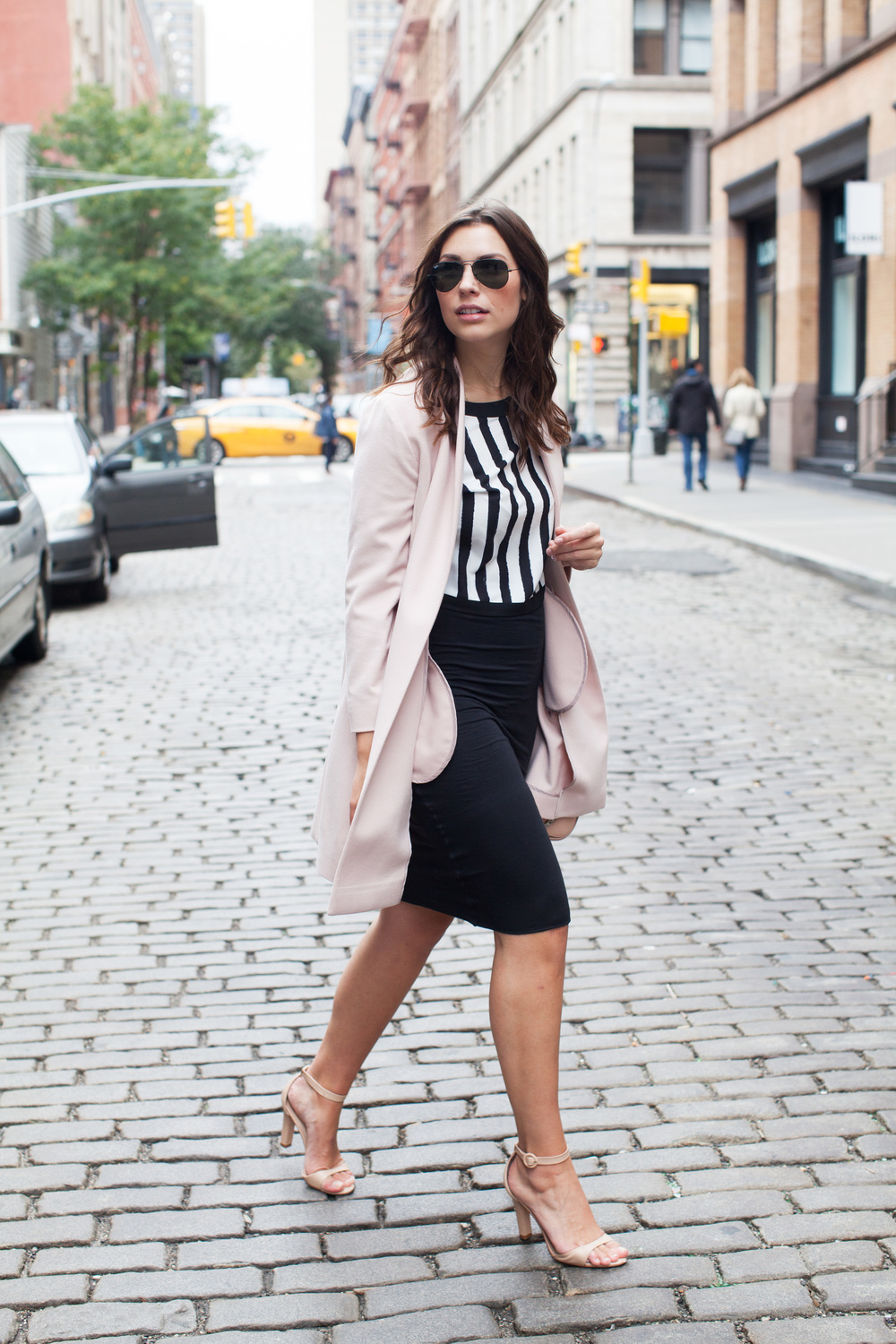 pink coat and stripe crop top and black pencil skirt