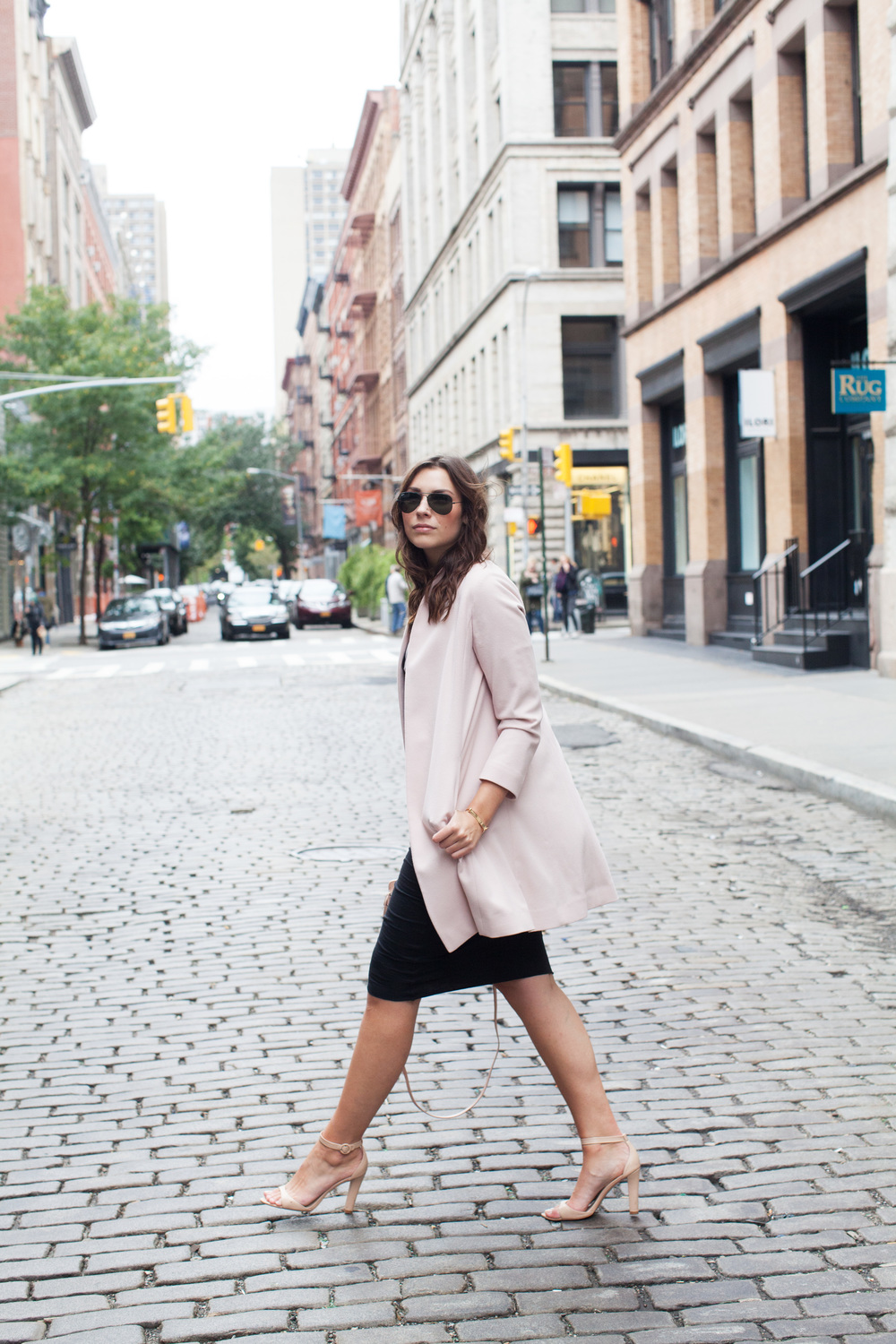 pink coat over black pencil skirt