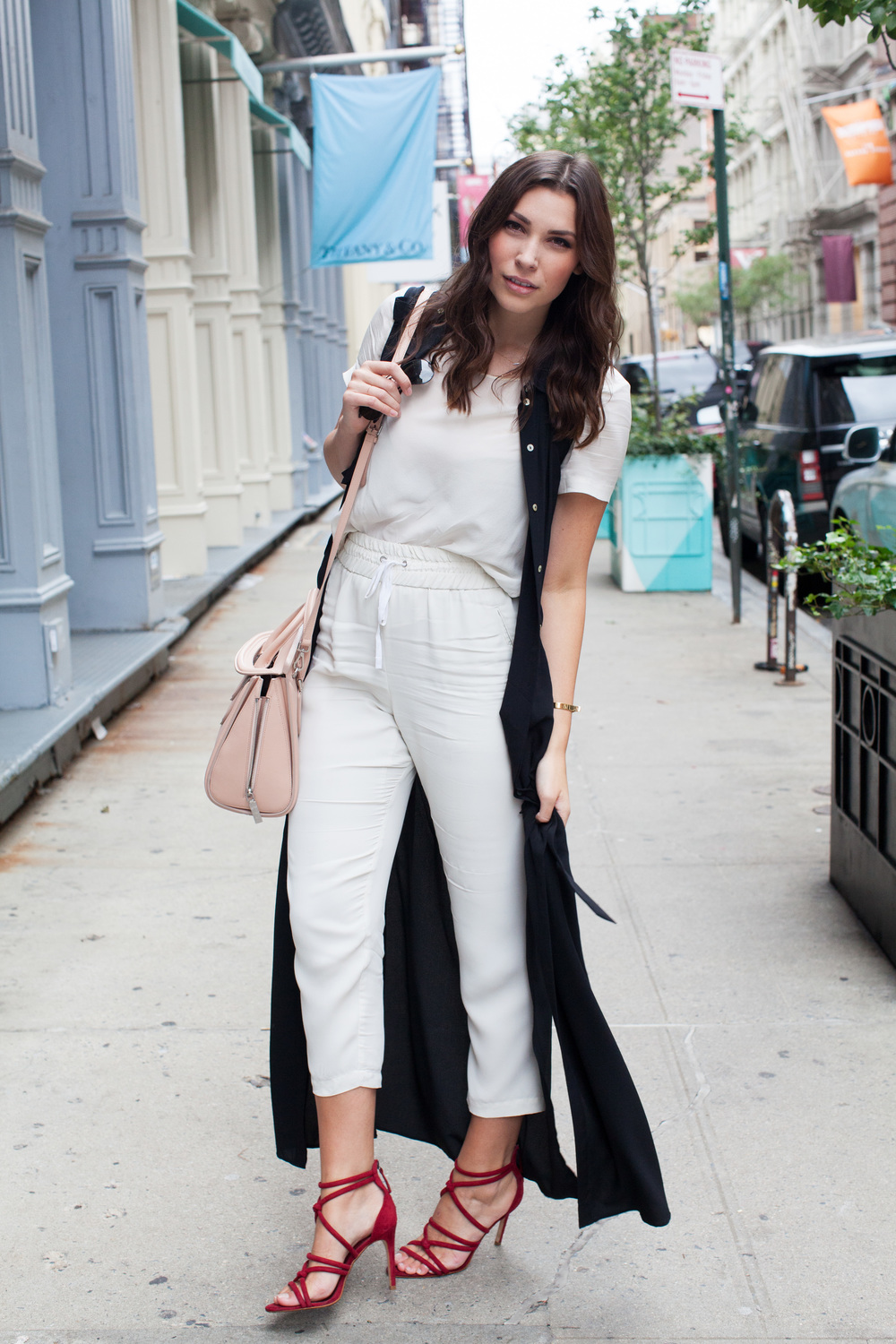 black duster, all white outfit, red zara shoes