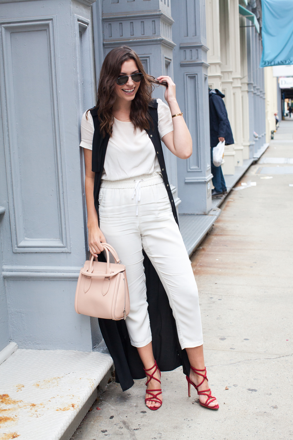 black duster, all white outfit, red zara shoes, alexander mcqueen bag