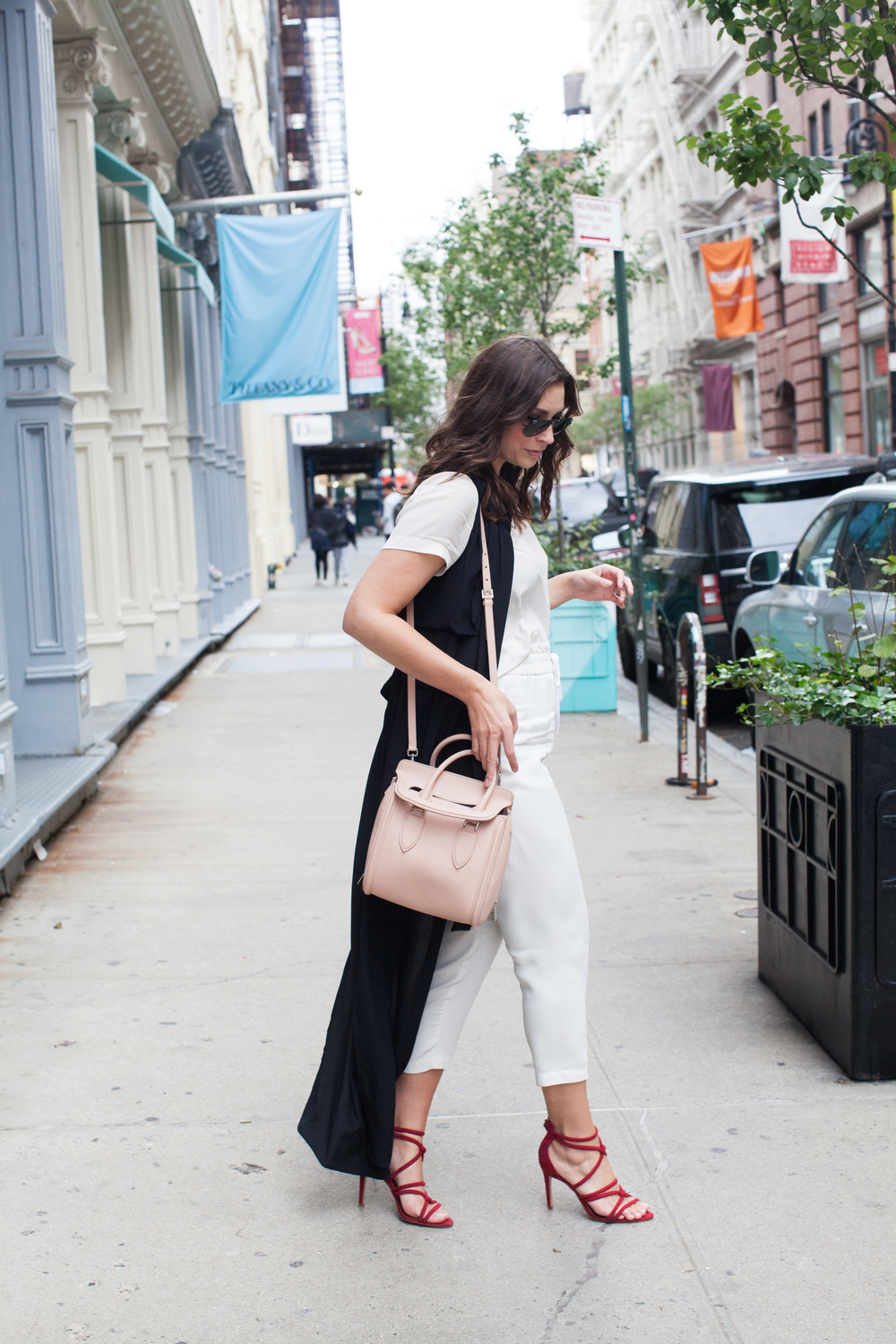 black duster coat, all white outfit