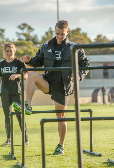 Demonstration of hip mobility drills for female gridiron players (Perth, Australia)