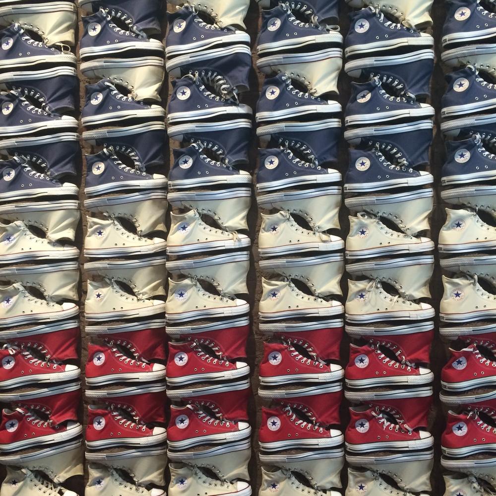 A wall of sneakers at Converse, my go-to walking shoes on this trip.