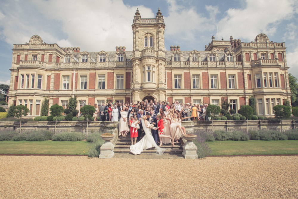 Andy, Jenni and their family and friends at Somerleyton Hall, by suffolk wedding photographer Him and Her