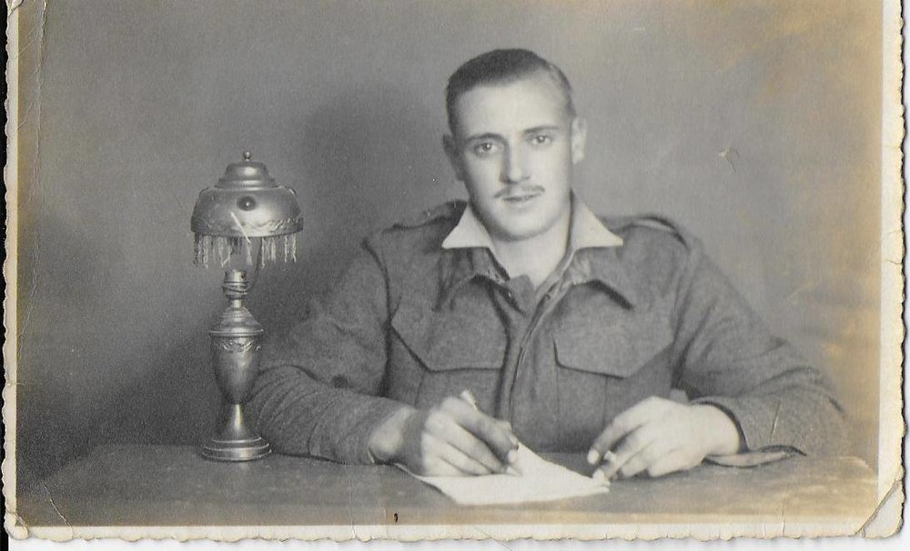 I know who this one is, it's my maternal Granddad Fred. I don't recall ever having much by way of in-depth conversation with him, and he was known as a bit of a miserable bugger in the family – but I love this picture. He was out in Africa at the time during WW2 and I can imagine him queuing with his mates whilst waiting for his turn to have a generic 'picture to send home'. He'd managed to keep his cigarette in one hand whilst pretending to write with the other and his hands are grubby as he'd probably been building an airfield. Nobody seemed to care there was no bulb in the ornamental lamp! He was later lucky to survive driving over a land-mine and went on to be a Butcher and Pig farmer in sleepy Norfolk. I can see my face in his face.