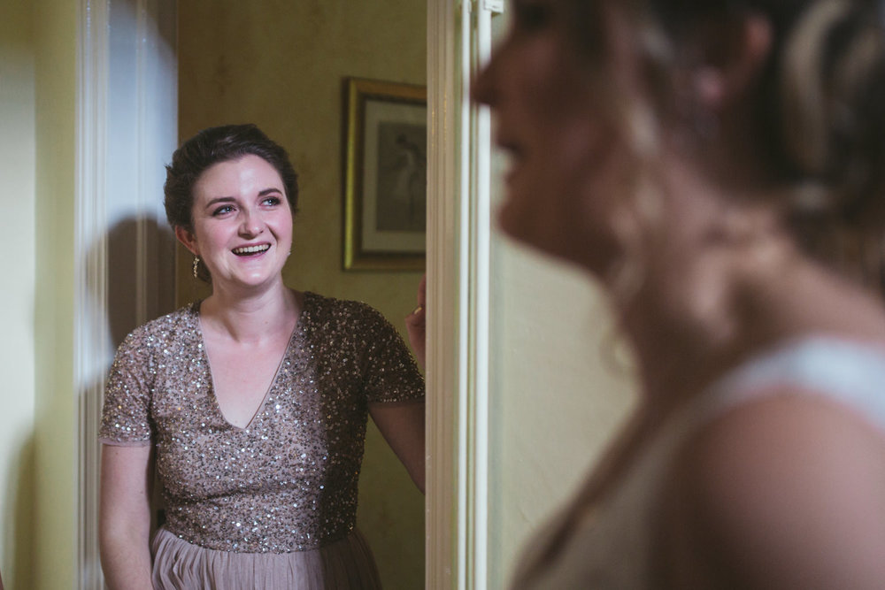 bridesmaid wells up at first view of Bride in wedding dress