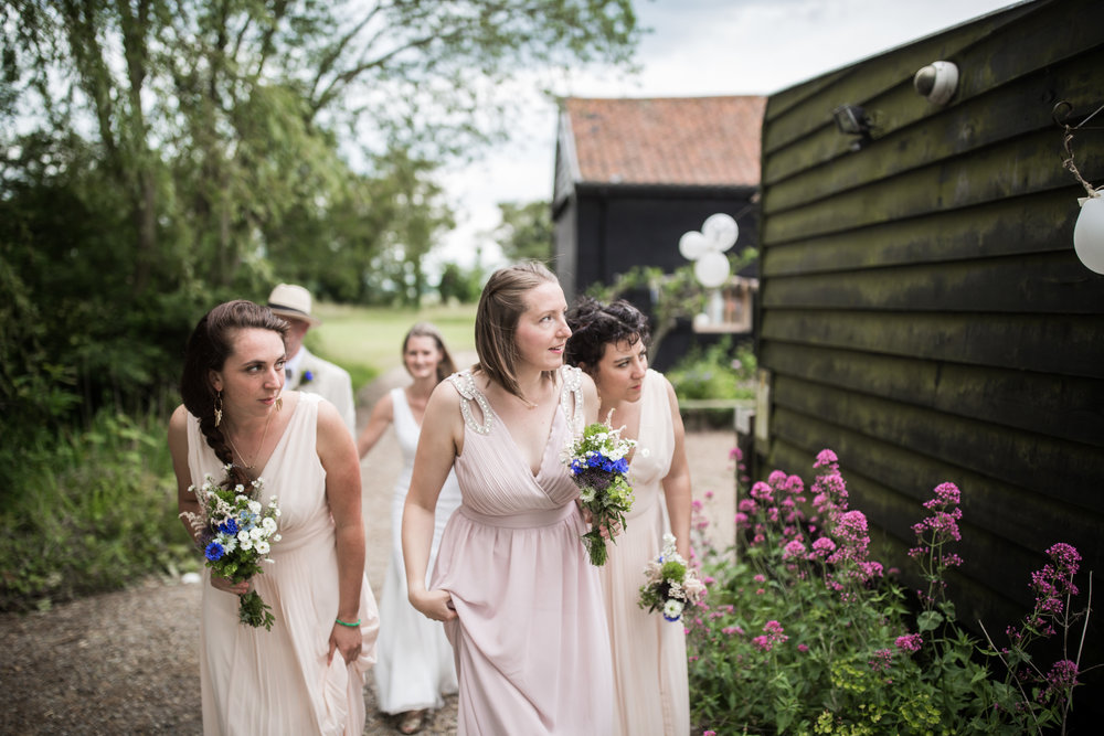 Bridal party pauses pre-ceremony at Thurstons Farm Saxmundham