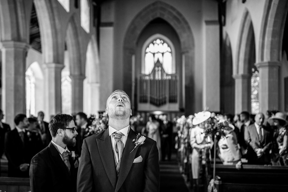 Nervous groom composes himself before his wedding in church