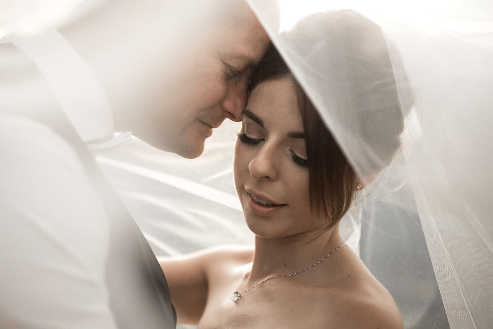wedding portrait under flowing veil