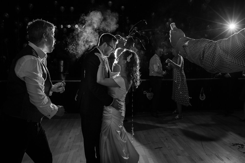 Wedding guests fire party poppers on couples first dance