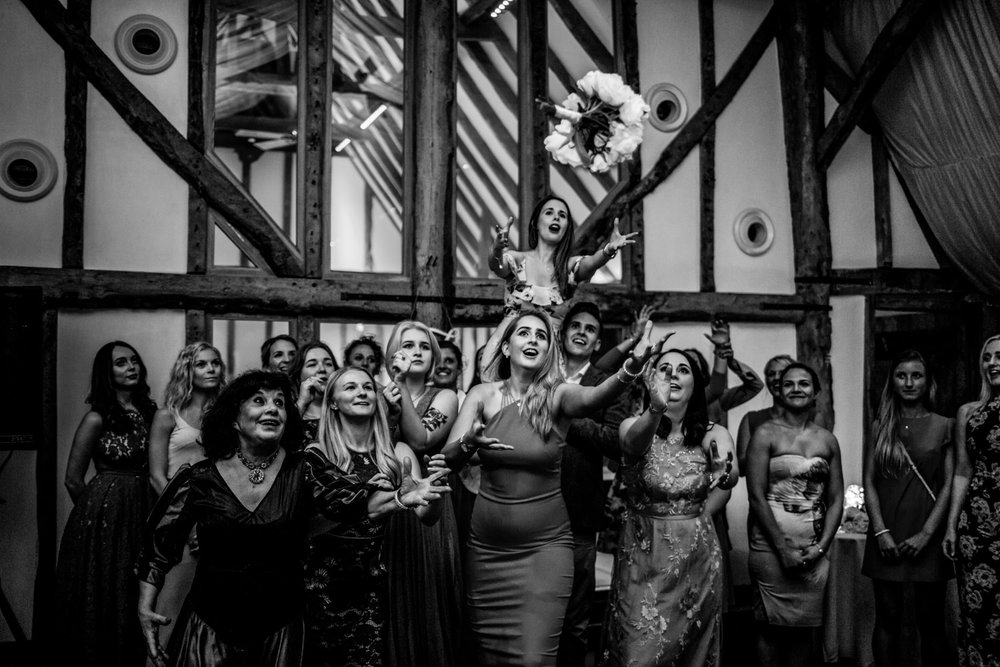 Bouquet is thrown to waiting ladies at south farm barn royston