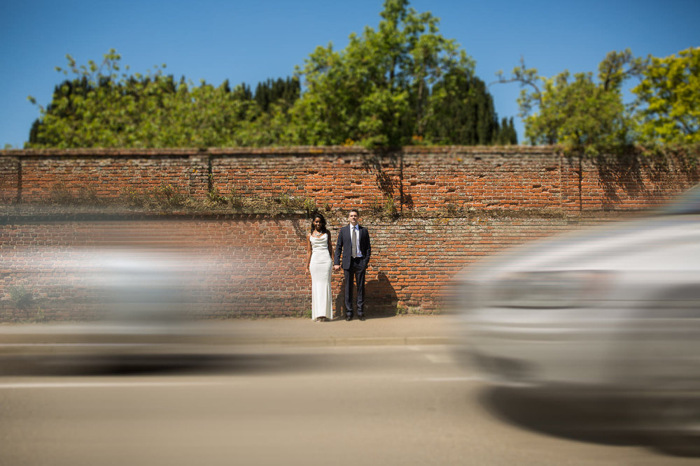 Long Melford historic wall portrait with moving traffic
