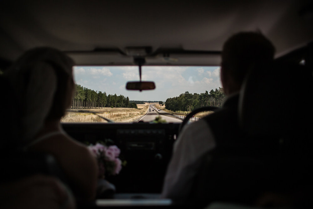 Father of the Bride drives her to church along A11 near thetford, Norfolk.