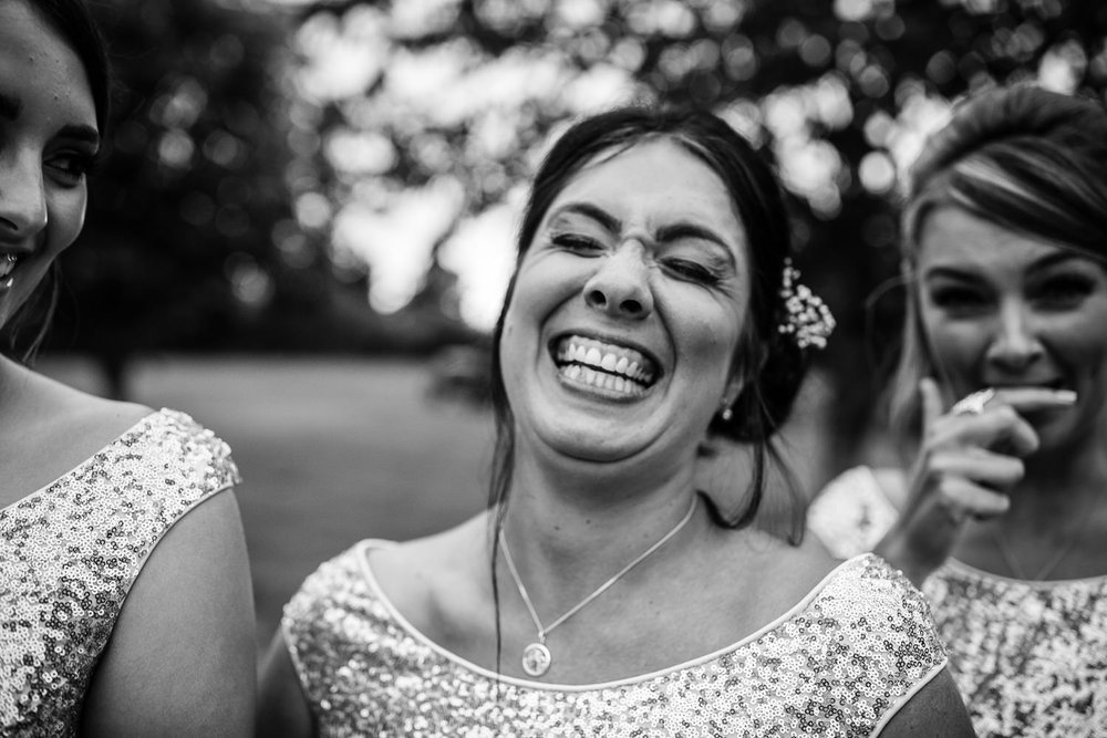 Bridesmaids giggle at Vaulty Manor in Essex