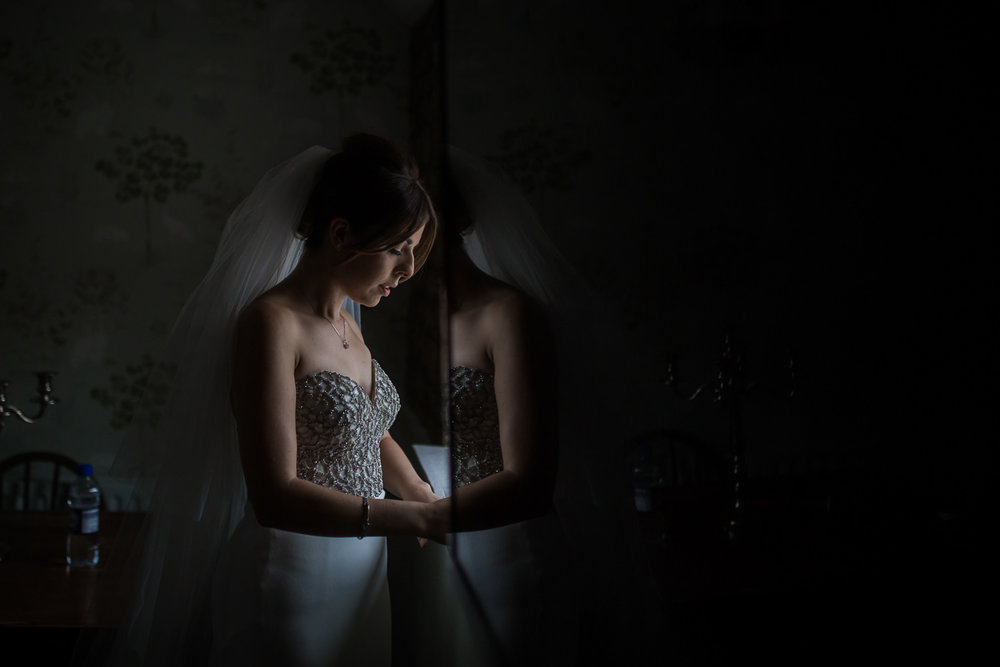Bride pauses in natural light before her wedding ceremony