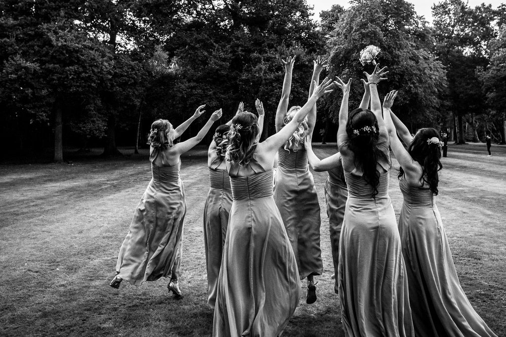 Bridesmaids rush to catch a bouquet at Milsoms, Ipswich