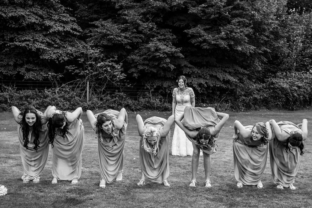 Bridesmaid surprise Bride with unlikely fun formal photograph