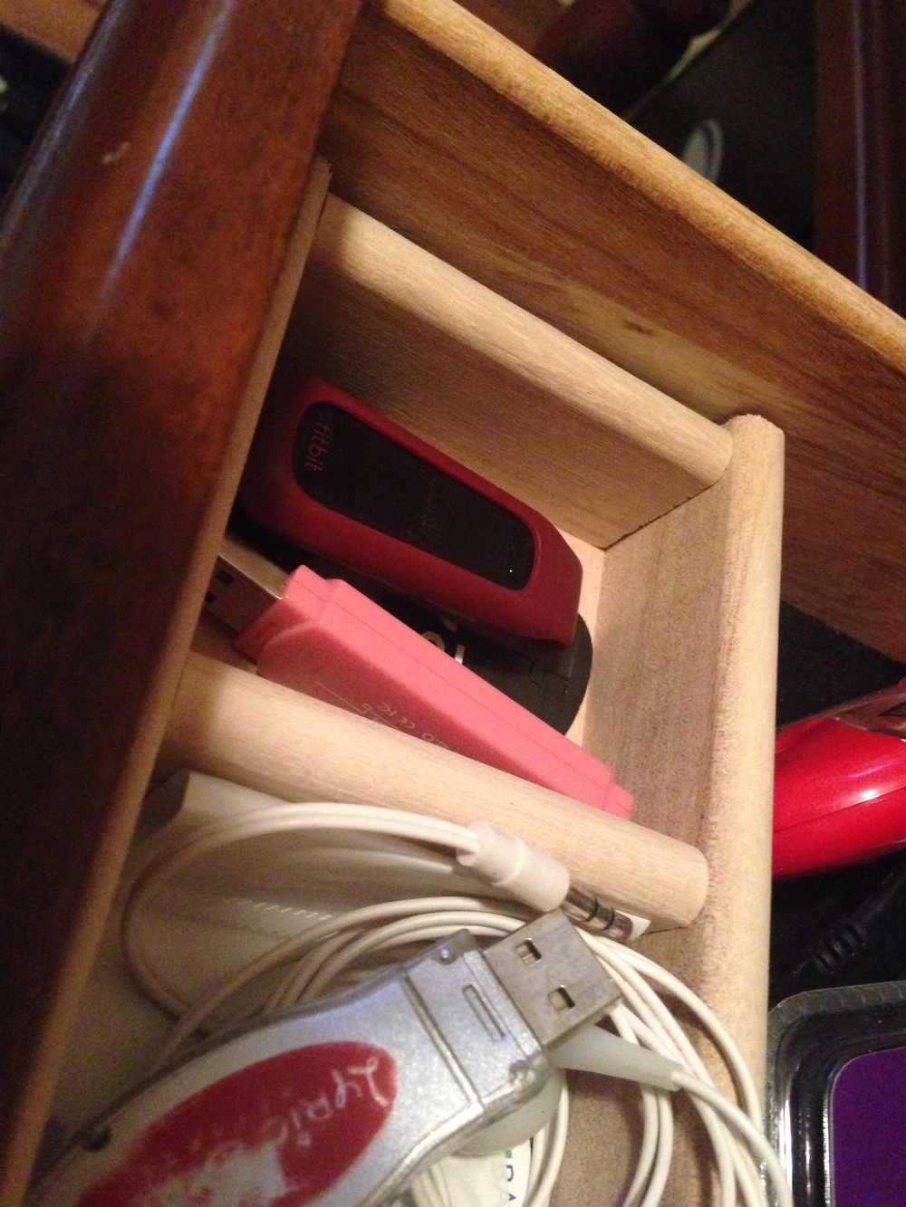 My FitBit's new home in the junk drawer where things go to die.