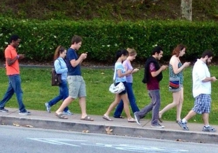 group-of-people-walking-and-texting.jpg