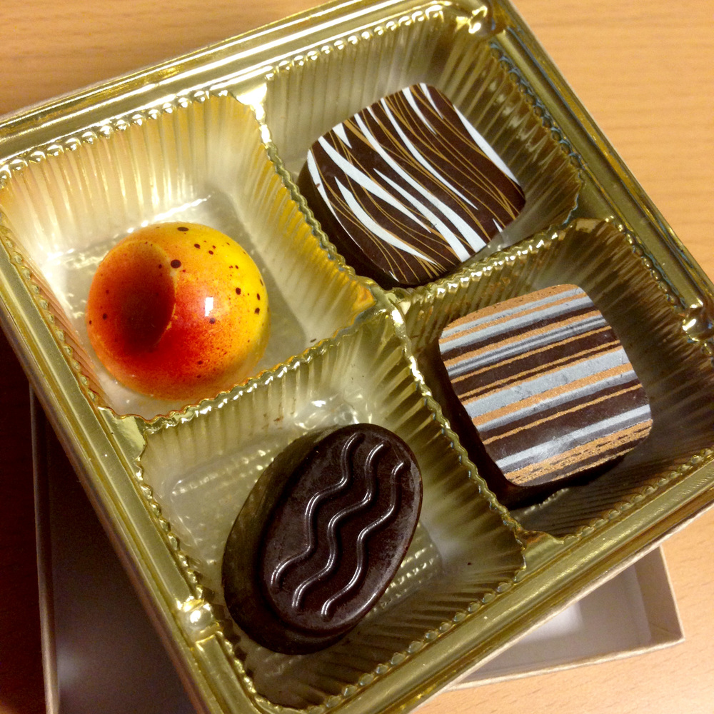 Delicious fancy chocolates from a client. These are sitting on my desk right now. OH EM YUM.
