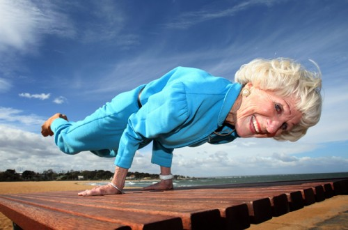 Bette Calman, doing peacock pose at age 83. (Photo source:  MindBodyGreen )