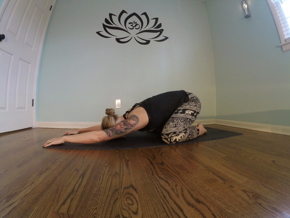 Child's pose (balasana) with knees wide