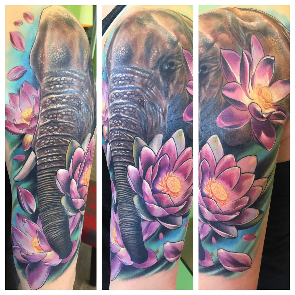 Elephant lotus half sleeve tattoo