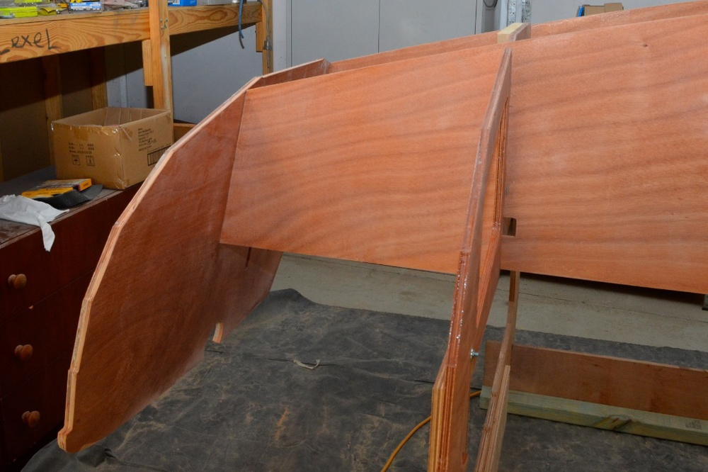 Transom is fitted by locating fore and aft frames into the mortices in the inner layer, these will be filleted later.