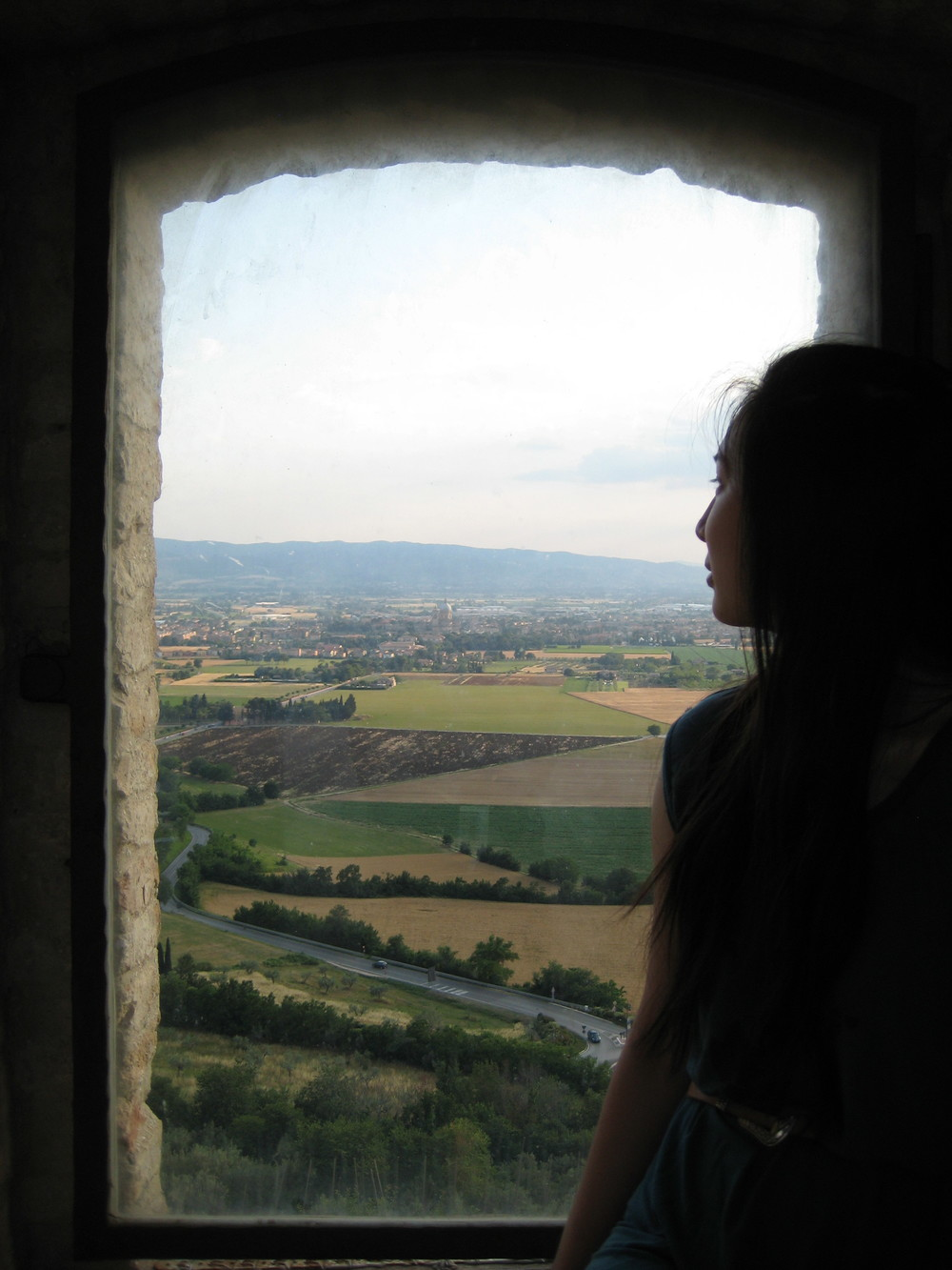 """Once a week, go somewhere where the sky meets the horizon and remind yourself that you are infinite."" This is me in in the St. Francis Basilica in Assisi, Italy."
