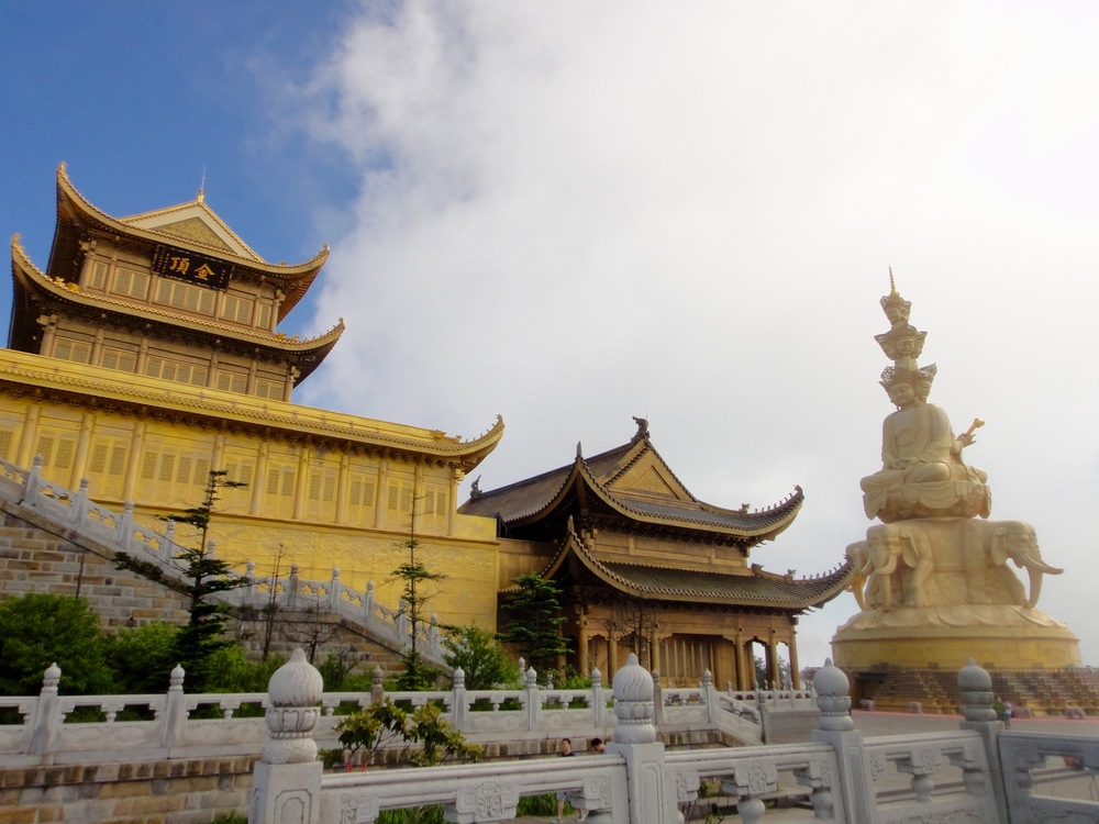 Golden summit on Mt. emei complete with temples and massive statue.