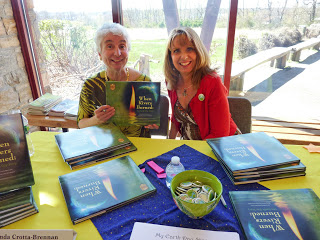 Linda and Lisa signing their book, When Rivers Burned: The Earth Day Story