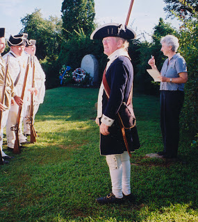 Linda Crotta Brennan gathering information at the reenactment of the Battle of RI.