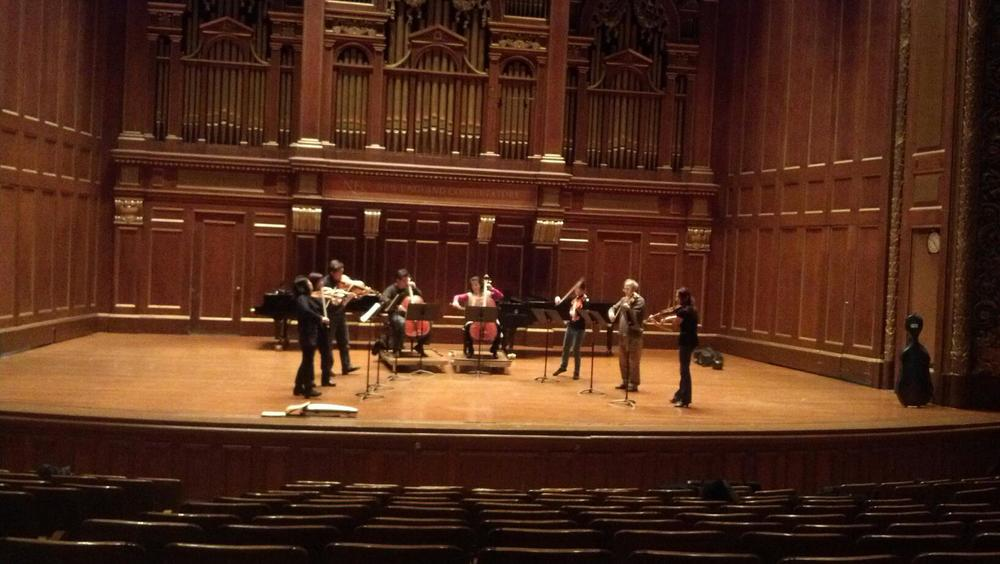 Chang prepares a 2013 performance in Jordan Hall with members of the Ying quartet.