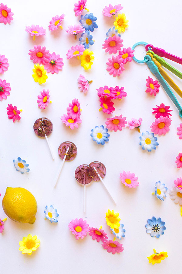 Floral Hard Candy Suckers | Today I'm sharing how to make your own floral lollipops. Hard candy is a true (and tempermental) artform, but that shouldn't shy you away from whipping up a batch of these on summer afternoon. With careful attention to detail, beautiful hard candy is achievable and well worth the effort.