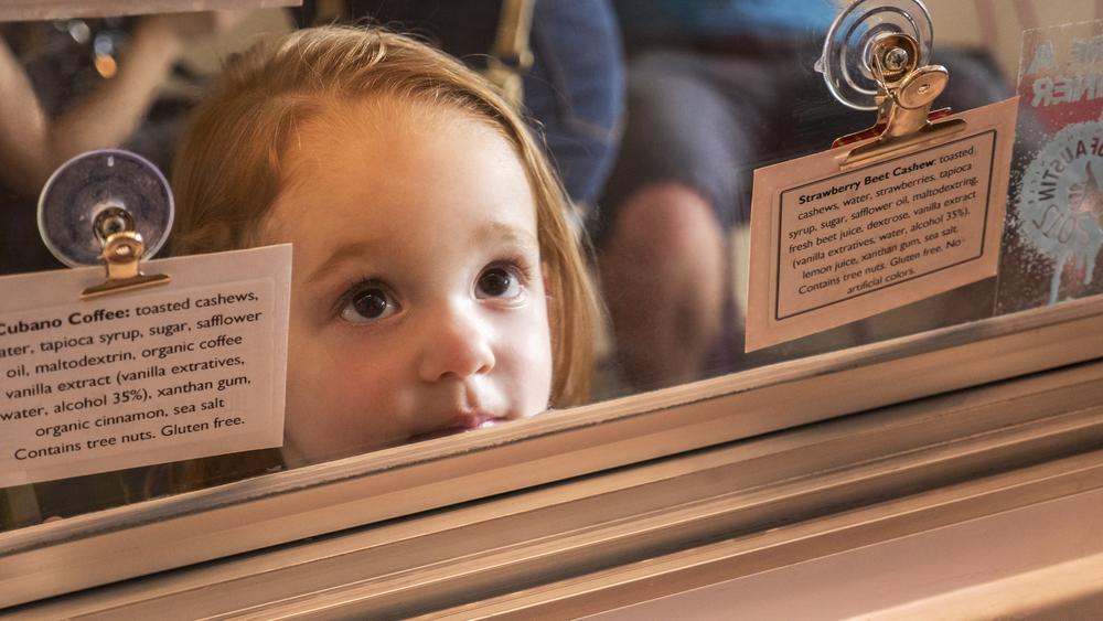 _1040131 customer girl looks up at scooper.jpg