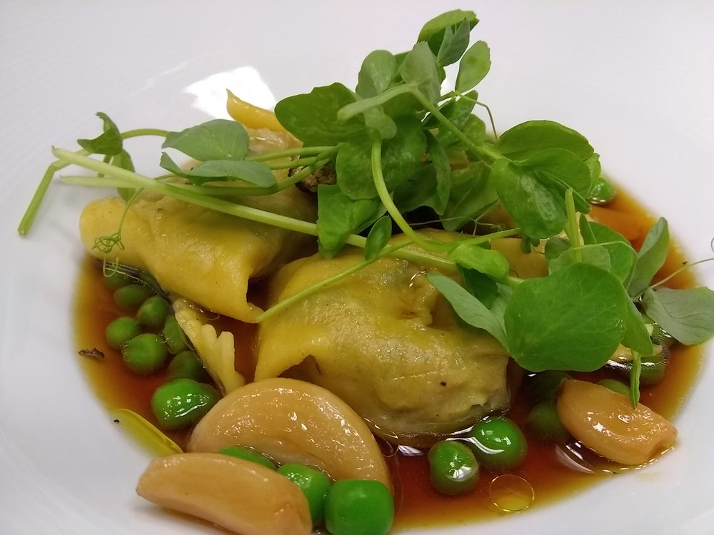 Agnolotti with black truffles in a peas and poultry broth.