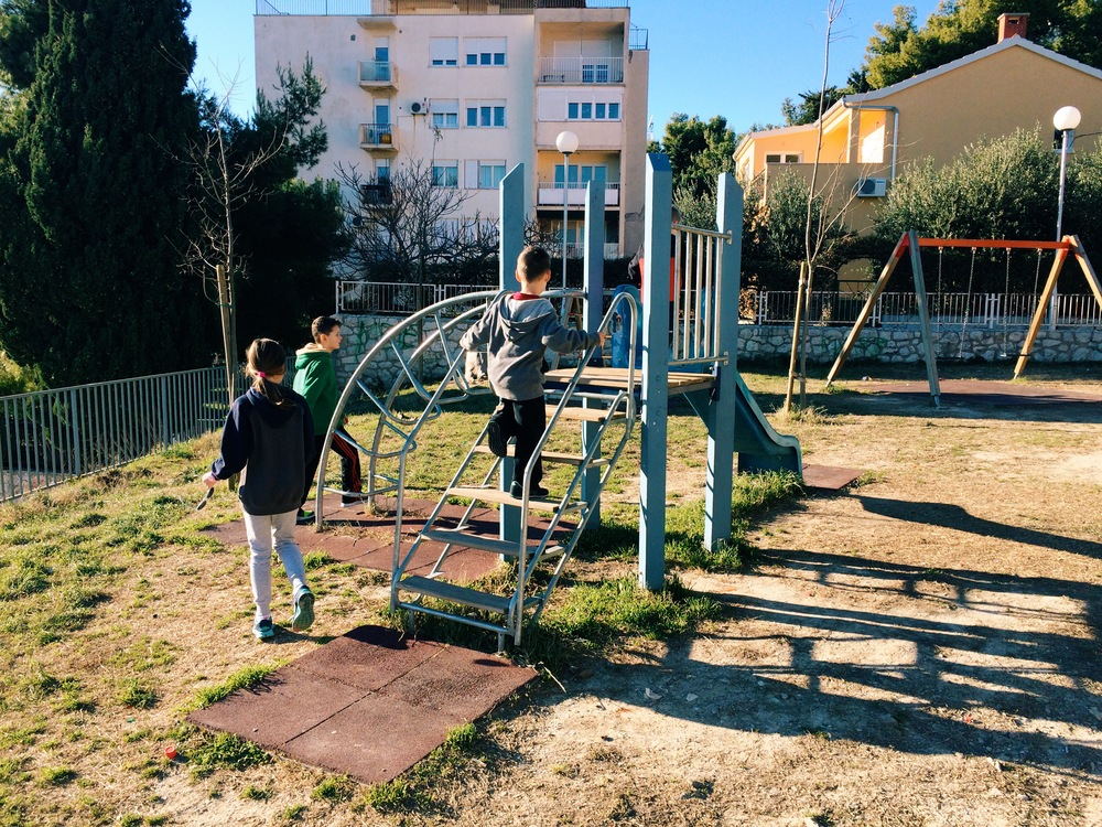 Exploring the playground at the kids' new school