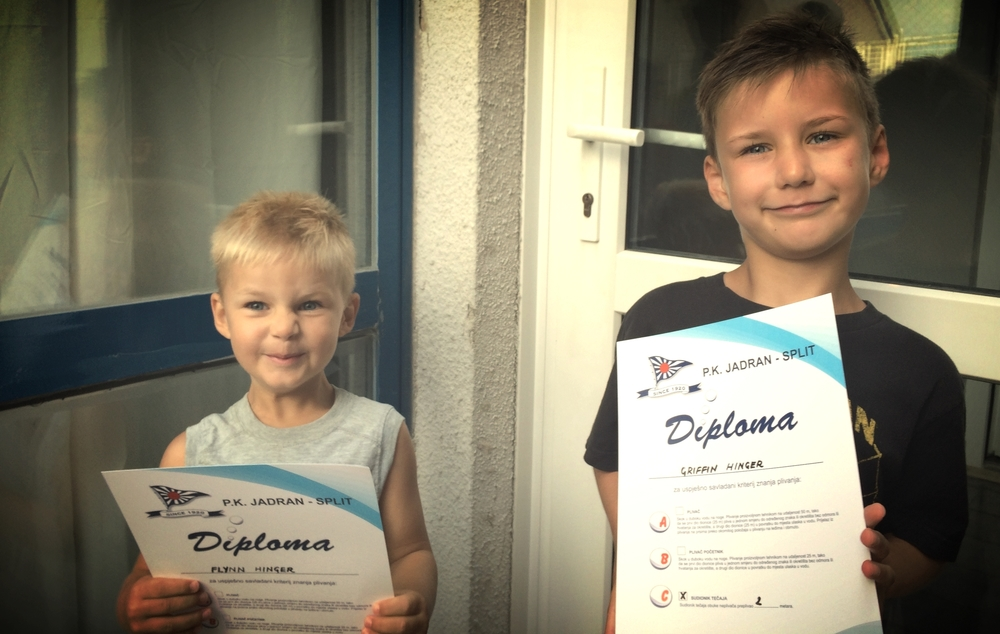 Flynn & Griffin with their swimming certificates