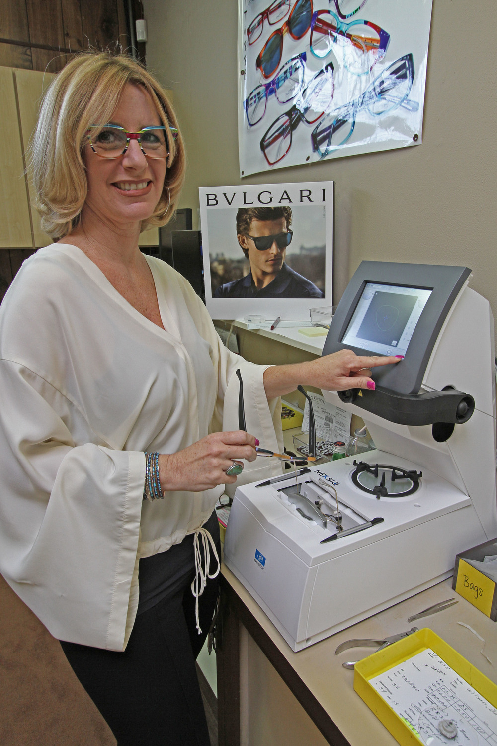 Astrid at work! Our state of the art Essilor edger.