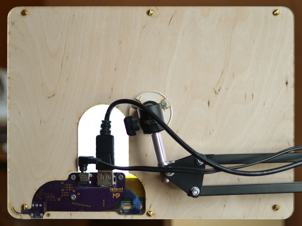 designed-to-be-lasercut chassis, version 2, rear view. LCD backlight illuminates the ports, helping you find them in the dark.
