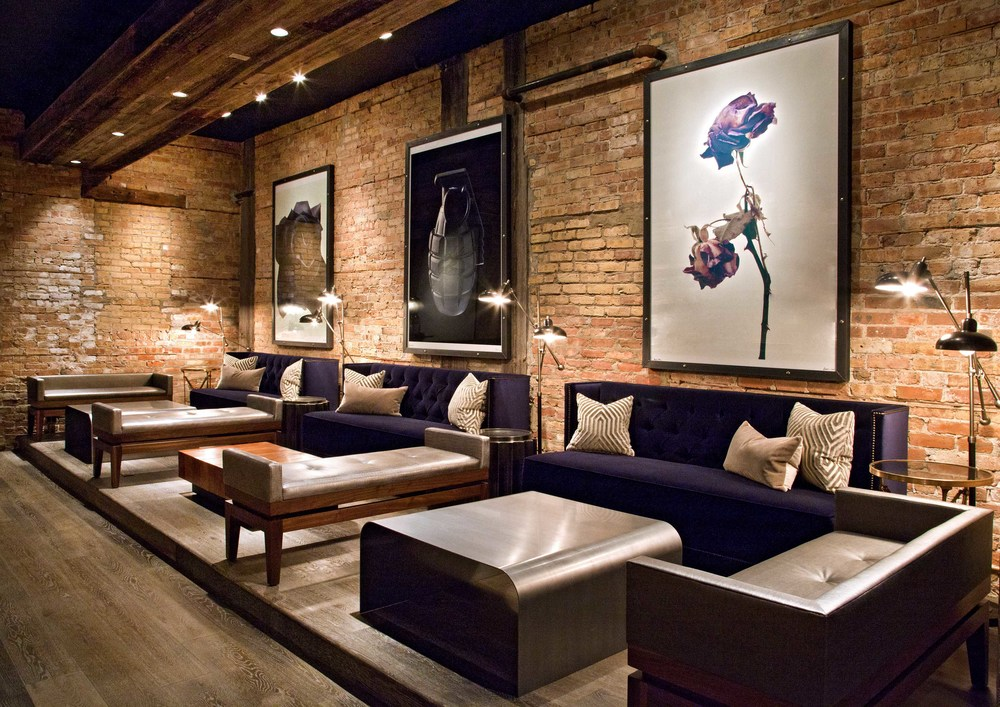 Presidio Chicago front lounge area. Loving the prints on the exposed brick wall!
