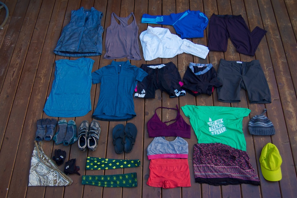 Row 1 (from top): Giro insulated vest, lightweight tank, Columbia button-down, UnderArmour base layer, Icebreaker wool leggings Row 2: Giro wool cycling jersey, sleeveless and sleeved, Triathlon riding shorts, Giro Undershorts, Giro Overshorts Row 3: Bandana, Injinji socks, Darn Tough Socks, Scott Ladies MTB cycling shoe, Luna Sandals, Rohan Cycling arm warmers, Lululemon bra, Icebreaker wool bra, Smart Wool Underwear, Woolrich t-shirt, thriftstore skirt, knit cap, Montbell ball cap